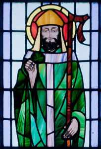 St. Patrick depicted with shamrock in detail of stained glass window in St. Benin's Church, Kilbennan, County Galway, Ireland. wikipedia