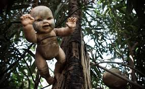 doll hanging from tree on Island of the Dolls, wikipedia