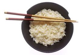 a bowl of rice with chopsticks, www.freestockphoto. biz